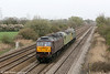 West Coast 47851 brings up the rear of convoy 0Z47 (comprising 57001/47768/47851), 1123 Barry to Carnforth at Coedkernew on 31st March 2011.