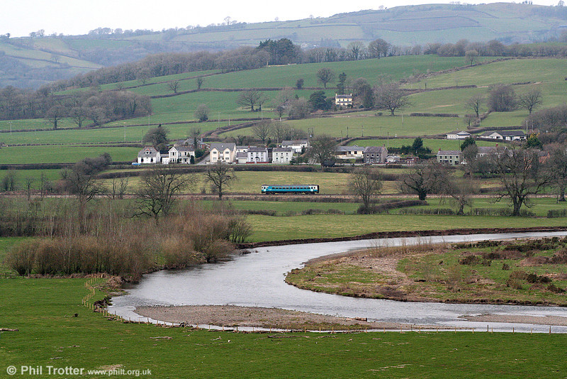 Heart of Wales Landscapes, 2: The 1316 service from Swansea to Shrewsbury passes the village of Manordeilo on 5th March 2011.