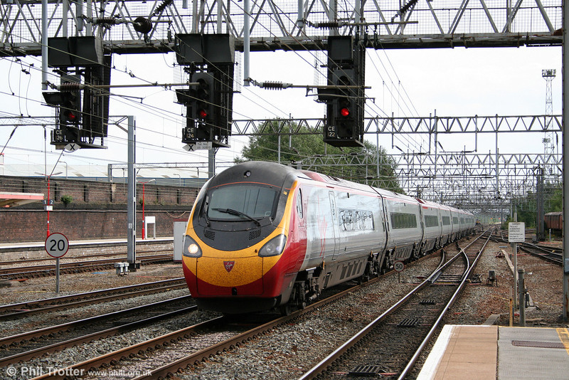 390020 ''Virgin Cavalier' heads north through Crewe forming the 1430 London Euston to Glasgow Central on 2nd August 2011.