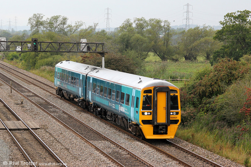 ATW's refurbished 158821 passes Coedkernew forming the 1217 Maesteg to Cheltenham Spa on 3rd September 2011.
