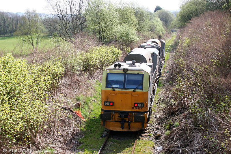Network Rail's MPV DR98909+DR98959 heads through Garnant on the Gwaun Cae Gurwen branch with a weed killing run from Margam on 17th April 2011.