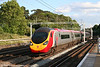 VWC Pendolino 390004 'Virgin Scot' heads for the north at Carpenders Park on 31st May 2011.