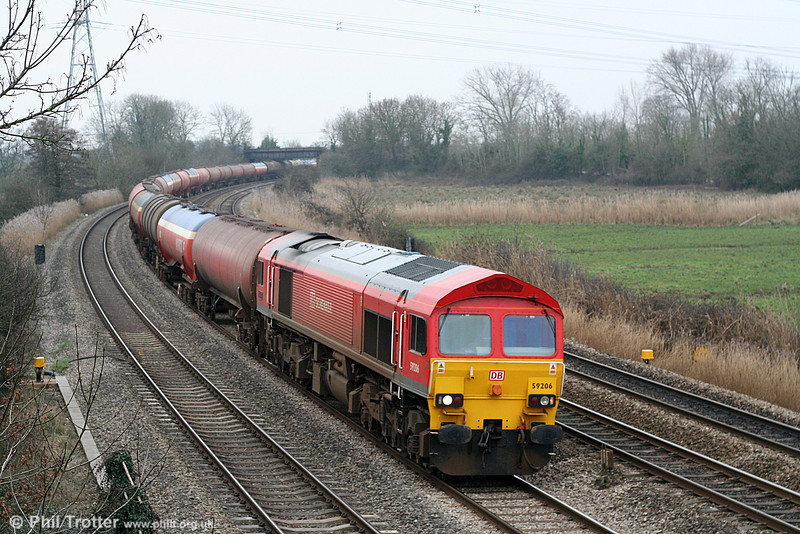 59206 'John F. Yeoman Railway Pioneer' passes Duffryn with 6B13, 0505 Robeston to Westerleigh on 1st March 2011.