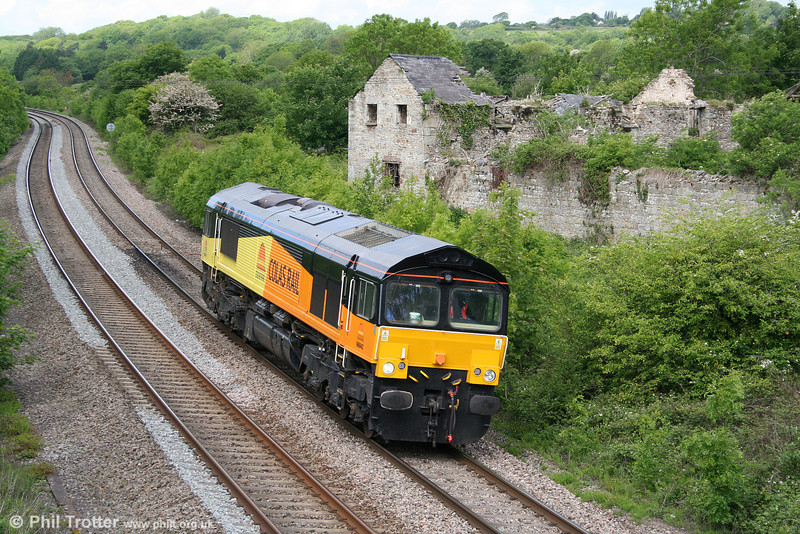 Colas 66842 runs light past Llangewydd en route from Margam to Llanwern on 13th May 2011.