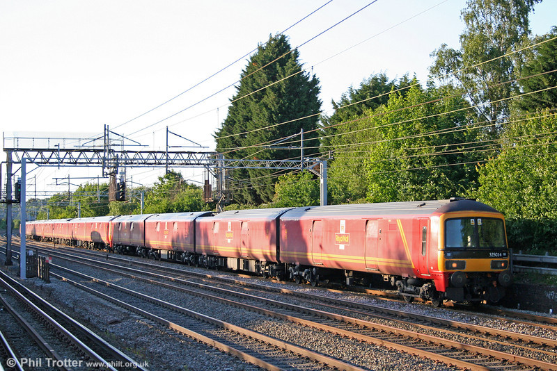 Three class 325 postal units at Carpenders Park, with 325014 heading 1A91, 1700 Warrington RMT to Willesden PRDC on 31st May 2011.