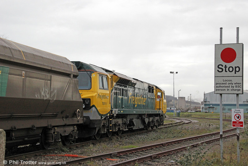 70011 proceeds down the Grange branch with 6Z97, 0911 Pengam to Margam (Grange) on 4th December 2011.
