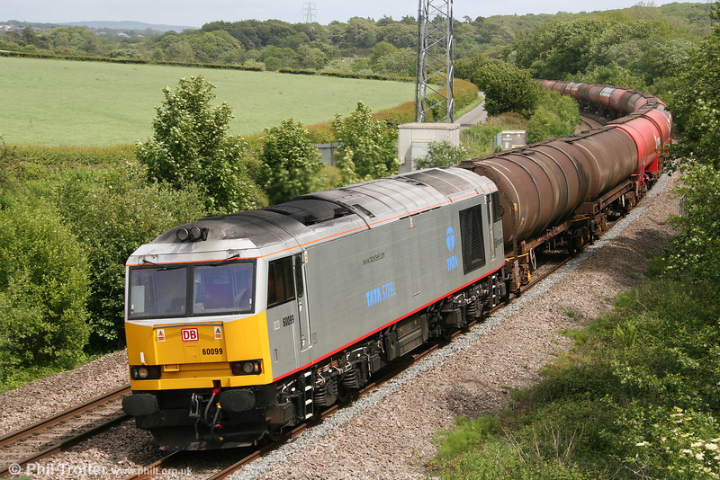 Tata Steel silver liveried 60099 passes Llangewydd with 6B33, 1212 Theale to Margam on 28th May 2011.