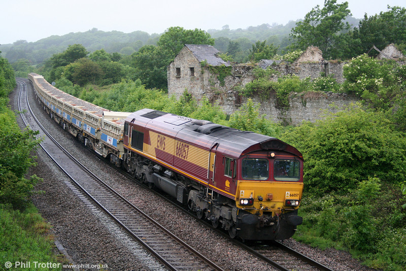 'Lickey Banker' 66057 passes Llangewydd with 6W06, Westbury to Cardiff Queen Street via Margam (to reverse) ballast train on 28th May 2011.