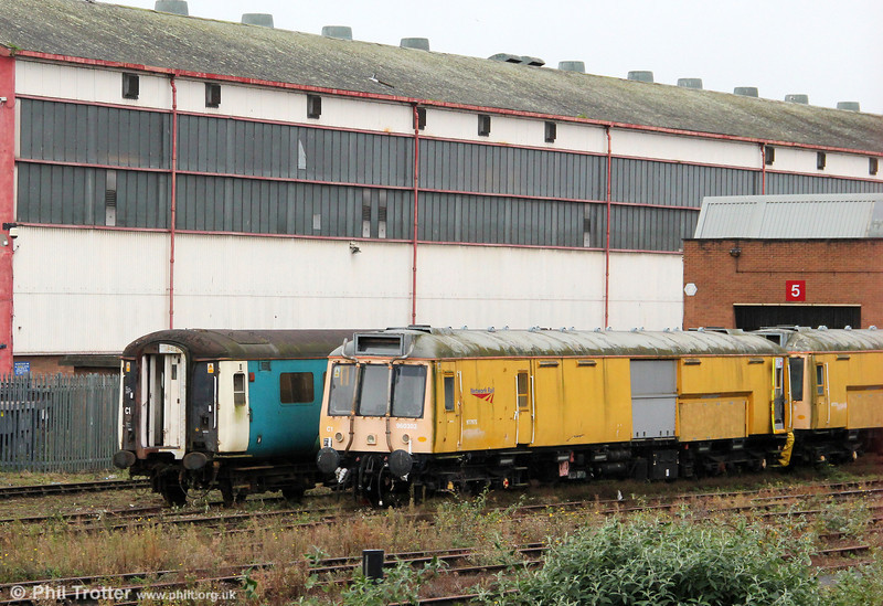 Former class 121 departmental 'bubble car' 977975 (55027) at Cardiff Canton on 5th October 2011. The unit is a source of spares for ATW's class 121 unit.