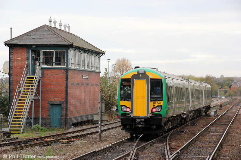 Stourbridge Junction Middle Signal Box was opened in 1901 with 91 levers. This was reduced to 60 levers in 1978 and an electronic panel was installed in 1990. 172345 passes forming the 1216 Worcester Foregate Street to Dorridge on 29th October 2011.