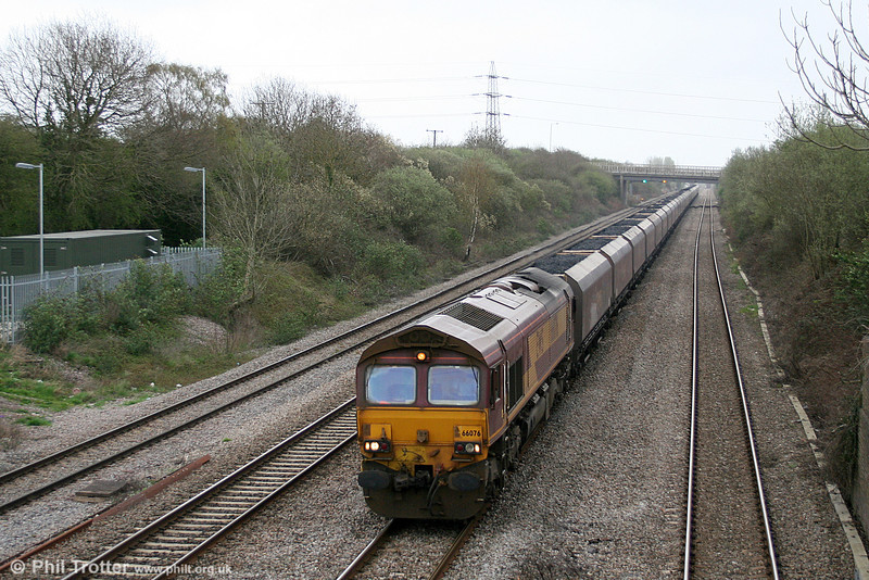 66076 passes Llandevenny with the lengthy 6V67, 0353 Redcar to Margam coke on 31st March 2011.