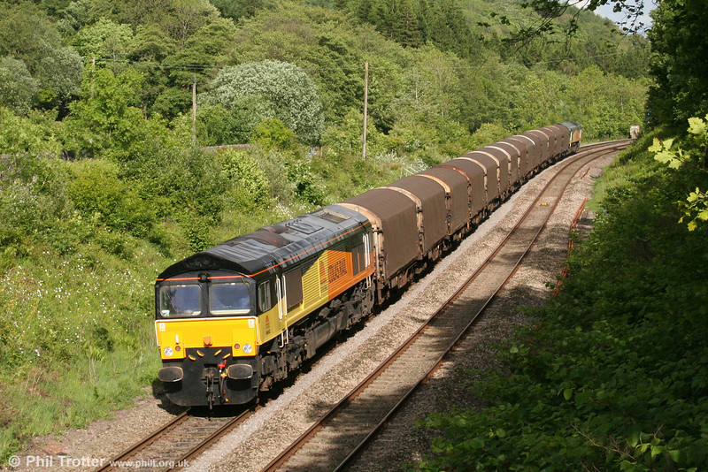66842 brings up the rear of 6Z79, Margam to Llanwern near Llanharan on 14th May 2011. The train was being  worked in top and tail mode with 66843 to facilitate entry to Llanwern during Newport area resignalling work.