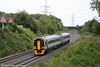 158841, still carrying the bland silver livery, passes Portskewett forming the 1145 Cheltenham Spa to Maesteg on 7th July 2011.