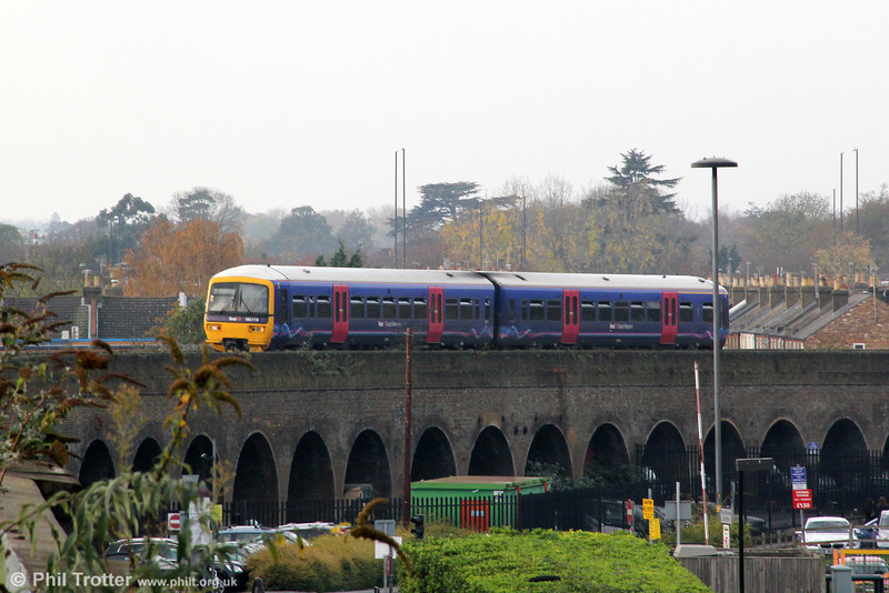 Windsor & Eton Central station is approached by a 2035 yard brick viaduct which is being crossed by 165119 on 12th November 2011.