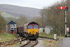 66121 runs onto the Gwaun Cae Gurwen branch at Pantyffynnon with 6G05, 0920 Swansea Burrows Sidings to GCG on 24th November 2011.