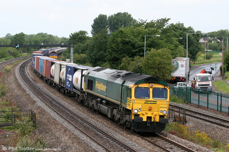 66542 passes Undy with 4O51, 0958 Wentloog to Southampton on 7th July 2011. 66075 waits in the background with 4E66.