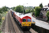 The latest DB Schenker repaint is 66097. The gleaming loco passes Eastbrook with 6B39, 1432 Barry Docks to Newport ADJ on 7th July 2011.