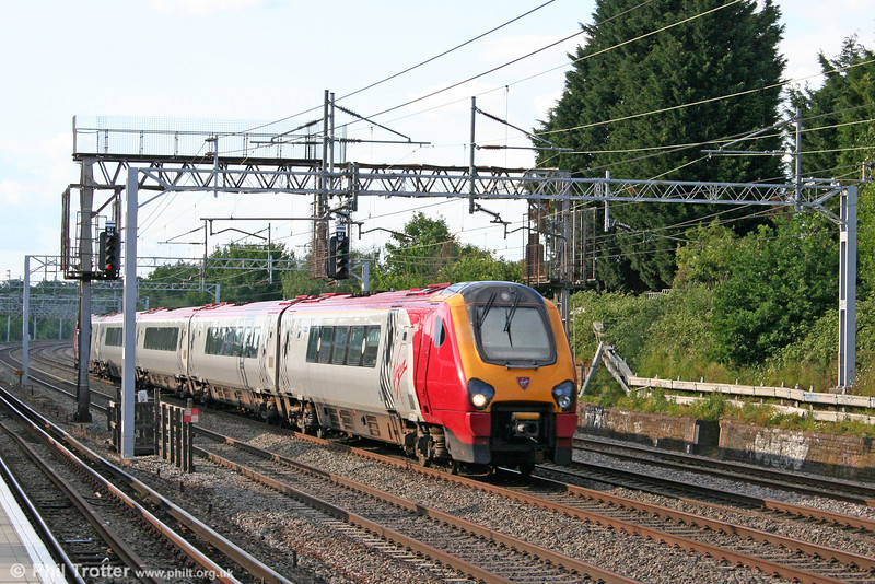 An unidentified VWC class 221 heads for London Euston at Carpenders Park on 31st May 2011.