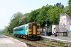 Bank Holiday getaway: There's plenty of custom for 153327 as it calls at Llandeilo forming the 0809 Cardiff Central to Shrewsbury on 29th April 2011. The mural was produced by students at Llandeilo.