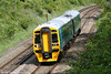 Refurbished ATW 158838 is seen near Llanharan forming the 1345 Cheltenham Spa to Maesteg on 14th May 2011.