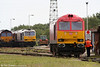DB Schenker liveried 60011 and Tata Steel liveried 60099 at Margam, Knuckle Yard on 28th May 2011.