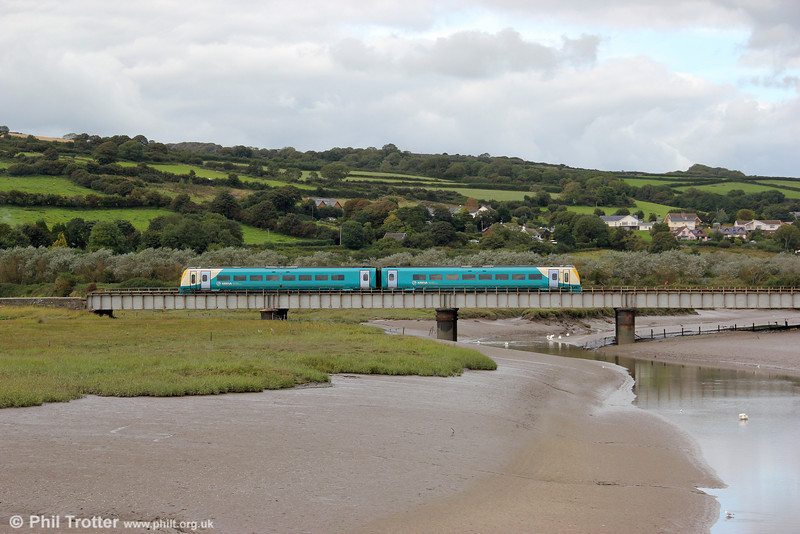 An ATW class 175 crosses the River Gwendraeth at Kidwelly forming the 1130 Manchester Piccadilly to Carmarthen on 29th August 2011.