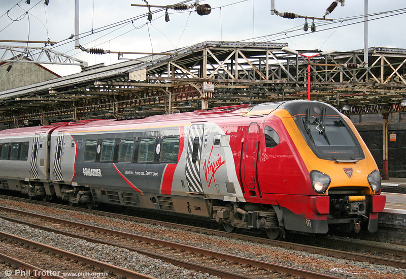 A closer look at 221115's Bombardier livery as it departs from Crewe for Birmingham New Street on 2nd August 2011.