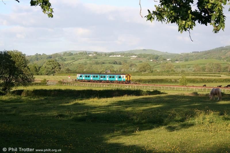 ATW's 1821 Swansea to Shrewsbury passes Manordeilo on 12th May 2011.