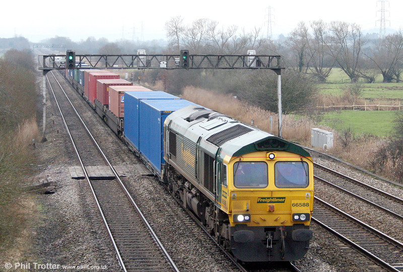 66588 passes Coedkernew with 4O51, 1244 Wentloog to Southampton on 22nd January 2011.