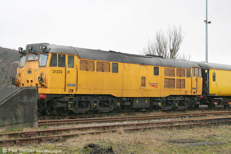 Brush Type 2 A1A-A1A 31233 sits at Maliphant Street sidings, Swansea waiting to leave with 1Q06, 1758 to Shrewsbury and Crewe Structure Gauging Train on 23rd February 2011. 31233 was built in 1960 as no. D5660.