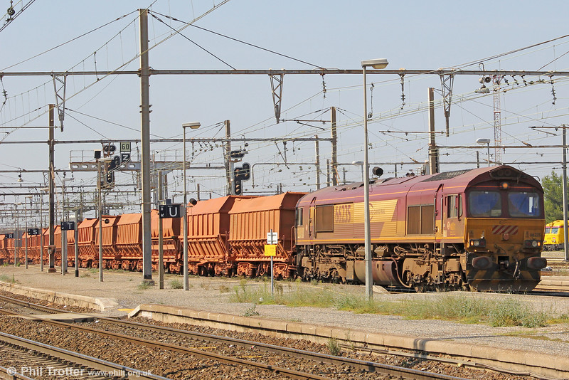 ECR/DB Schenker 66235 passes through Miramas with a Fos to Gardanne Bauxite train - which the type operate in top and tail mode - on 26th September 2011.