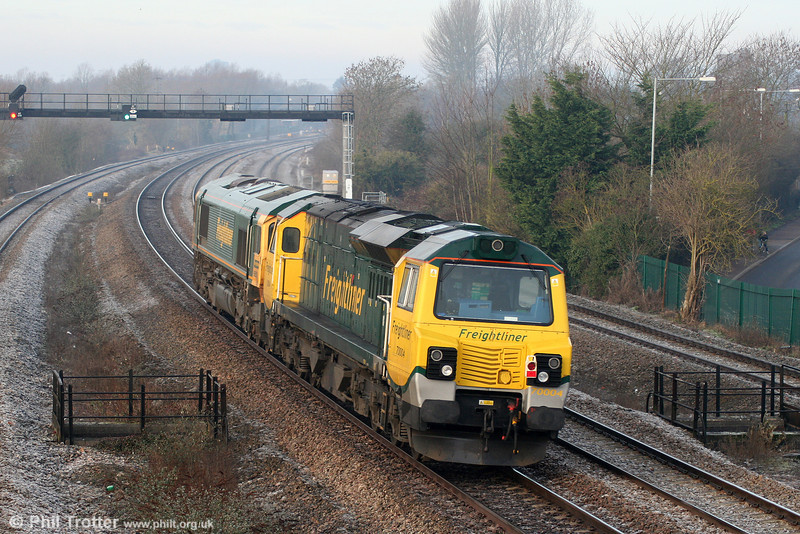 66621 drags 70004 through Undy on Stoke Gifford to Crewe, Basford Hall move 0Z25 on 22nd January 2011.
