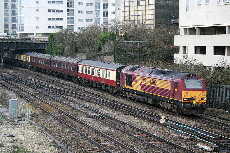 Complete with daffodil, 67021 leaves Cardiff Central with 1Z55, 0733 Swansea to Edinburgh Waverley 'Rugex' on 11th February 2011.