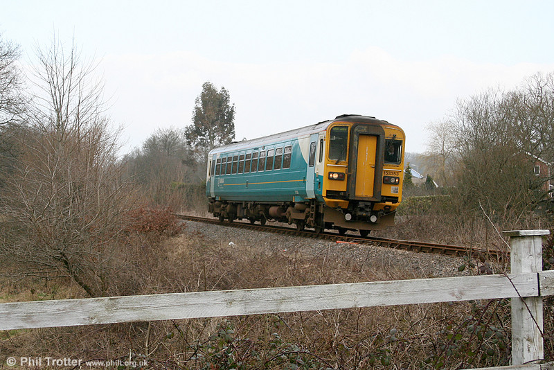 The late running 0905 Shrewsbury to Cardiff Central approaches Brynmarlais Crossing, Llandybie on 5th March 2011.