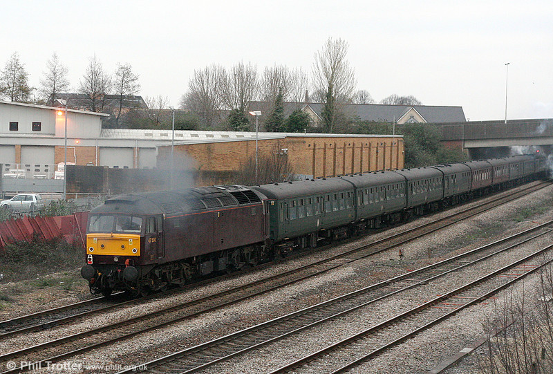 47500 (in a previous life named 'Great Western') evidently lends a hand to LMS Black 5 44932 as it leaves Cardiff at the rear of 1Z73, 1643 Cardiff Central to London Victoria on 1st March 2011.