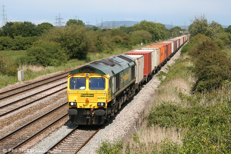 66593 '3MG Mersey Multimodal Gateway' passes Coedkernew with 4V64, 1108 Crewe Basford Hall to Wentloog on 11th June 2011.