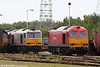 DB Schenker liveried 60011 and Tata Steel liveried 60099 on the fuelling point at Margam, Knuckle Yard on 28th May 2011.