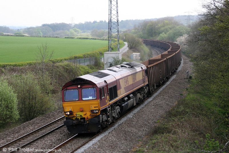 66141 passes Llangewydd with empty scrap wagons for Margam on 16th April 2011.