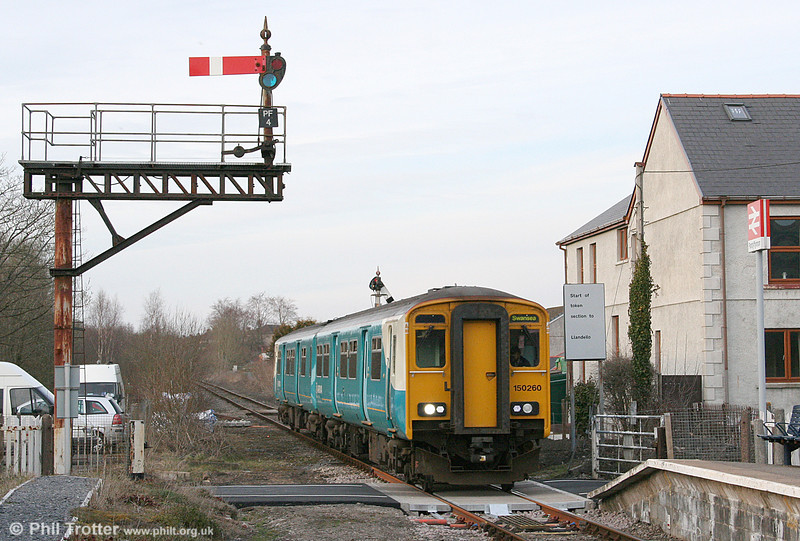 150260 on the newly relaid level crossing at Pantyffynnon, forming the 1405 Shrewsbury to Swansea on 19th March 2011.
