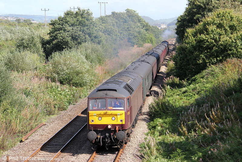 West Coast's 47500 passes Llanllwch with the Carmarthen to Pembroke Dock section of The Railway Touring Company's 1Z24, 0815 Bristol Temple Meads to Carmarthen and Pembroke Dock, 'The Pembroke Coast Express' on 11th September 2011.