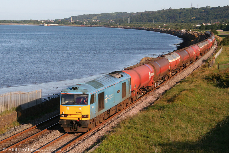 The early morning sunshine highlights 60074 'Teenage Spirit' at Cefn Padrig Bay, Llanelli with 6B13, 0505 Robeston to Westerleigh on 29th June 2011.