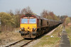 66092 awaits its path at Aberdare High Level with 6C45, 1054 Tower to Aberthaw Power Station on 26th March 2011.