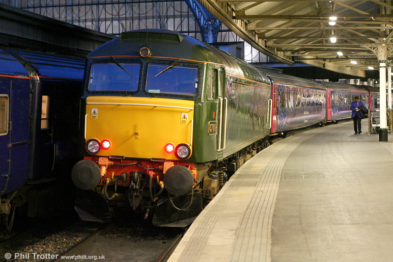 Great Western liveried 57604 'Pendennis Castle' waits at London Paddington with 1C99, 2345 London Paddington to Penzance, 'The Night Riviera' sleeper on 31st May 2011. 57604 was originally class 47 no. D1859, later becoming 47209 and 47393.