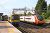 378220 calls at Carpenders Park forming the 1821 Watford Junction to London Euston on 31st May 2011. A VWC Pendolino rushes past on the up fast.