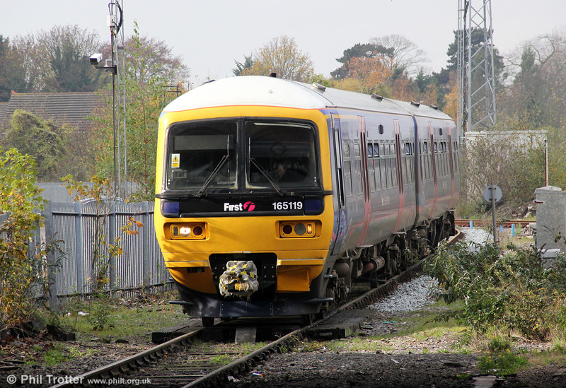 The 2½ mile Slough to Windsor branch was opened on 8 October 1849 as a broad gauge line; dual gauge track was laid in 1862. 165119 approaches Slough forming the 1207 from Windsor & Eton Central on 12th November 2011.