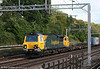 70007 heads north through Carpenders Park with 4M93, 1436 Felixstowe to Lawley Street on 31st May 2011.