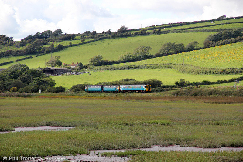 Returning towards Kidwelly, the 1509 Pembroke Dock to Swansea is seen on 29th August 2011,