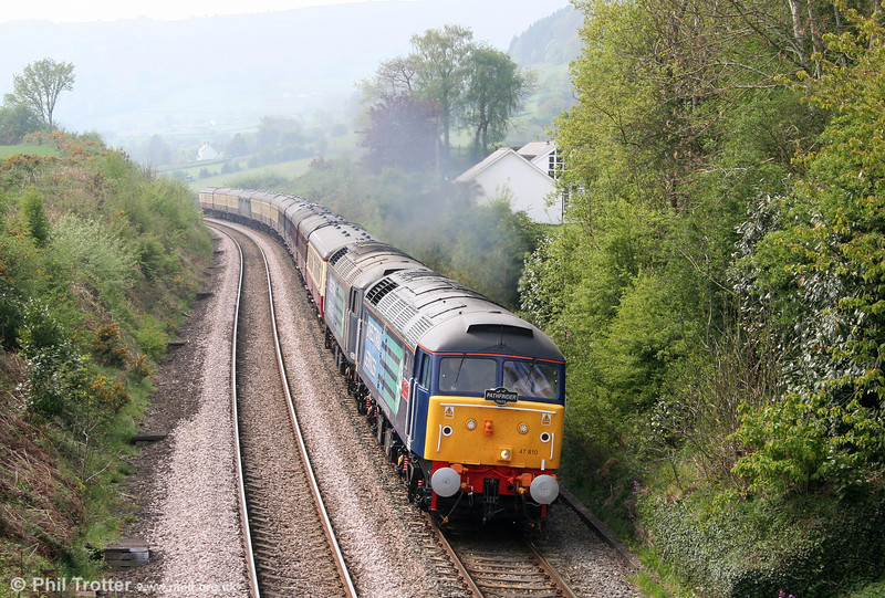 DRS 47810 (newly named 'Peter Bath MBE') and 47501 'Craftsman' climb through Penyclawdd with Pathfinder's heavily delayed 1Z21, 0551 Salisbury to Carlisle, 'The Easter Highlander' on 22nd April 2011.