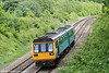 142085 is seen near Llanharan forming the 1314 stopping service from Cardiff Central to Swansea on 14th May 2011.