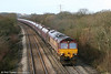 66166 climbs Stormy Bank with the lengthy 4E66, 1020 Margam to Redcar coke empties on 12th February 2011.